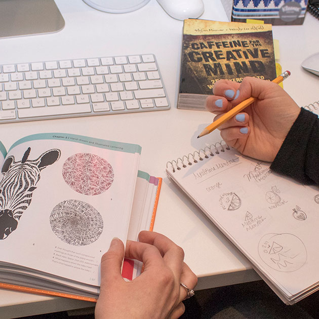 Graphic designers collaborating on marketing