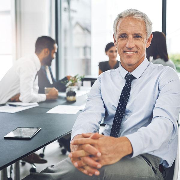 Man smiling during meeting