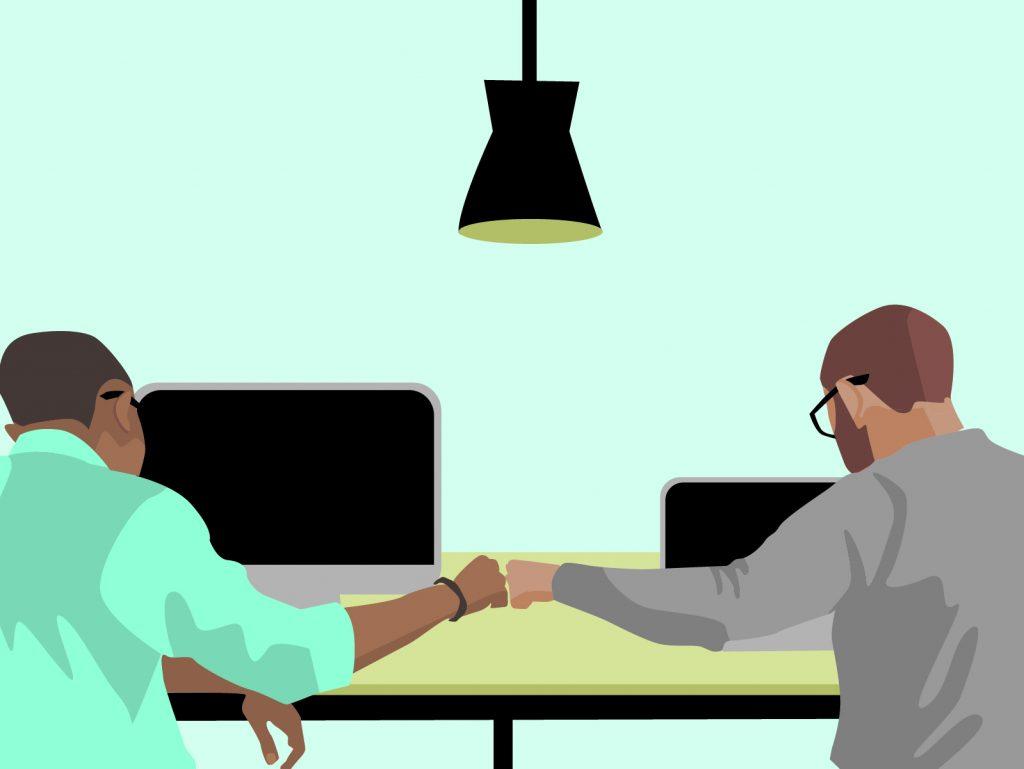 Employees sharing a fist-bump